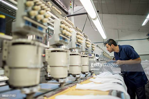 Man working at a clothing factory