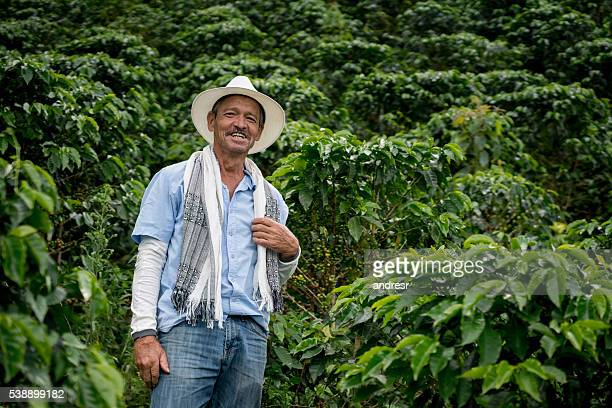 man working at a coffee farm - südamerika stock-fotos und bilder