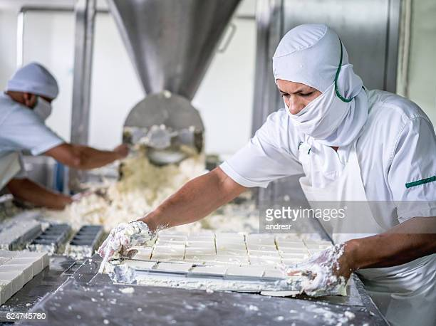 Man working at a dairy factory