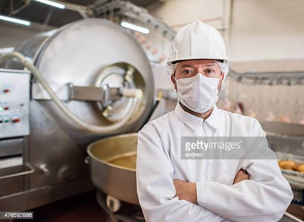 man working at a food factory - meat stock pictures, royalty-free photos & images