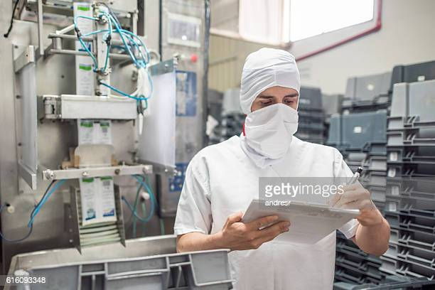 Man working at a food processing plant