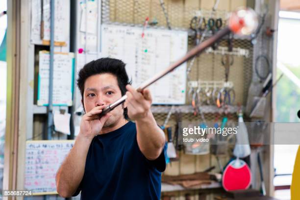 Man working at a glass factory
