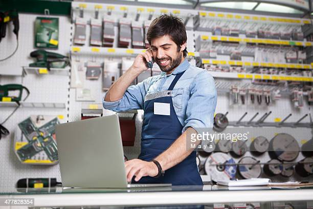 man working at a hardware store - demanding stock pictures, royalty-free photos & images