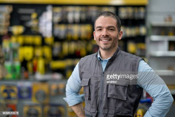 man working at a hardware store - salesman stock pictures, royalty-free photos & images