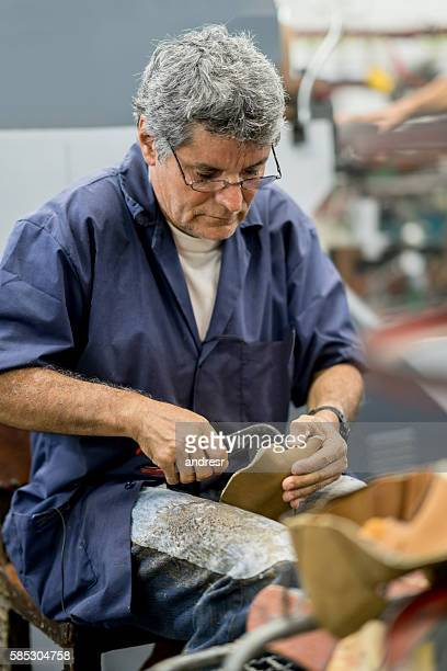 Man working at a shoe-making factory