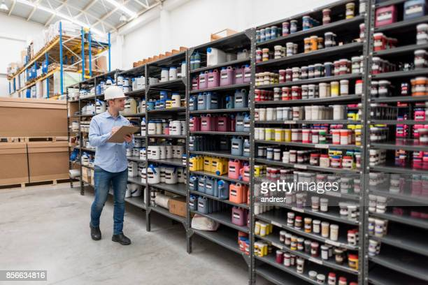 Man working at a warehouse doing an inventory