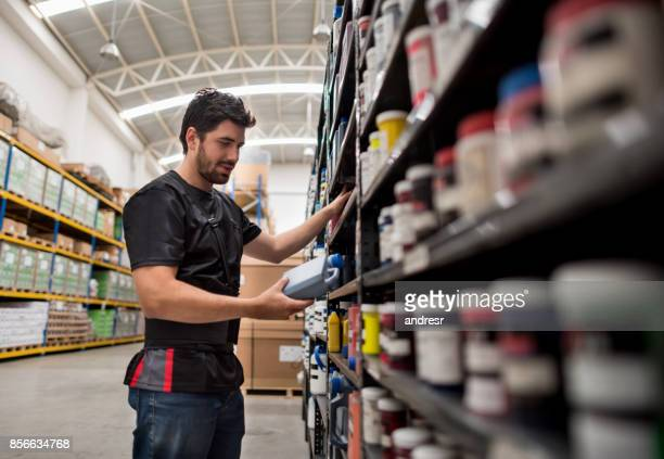 Man working at a warehouse organizing chemical products