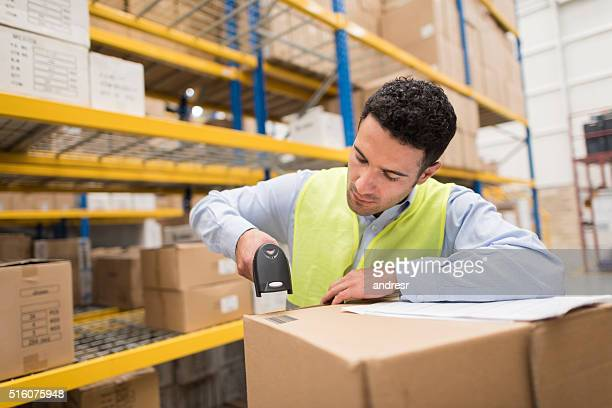 Man working at a warehouse scanning products