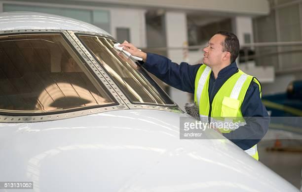 Man working at an airplane hangar