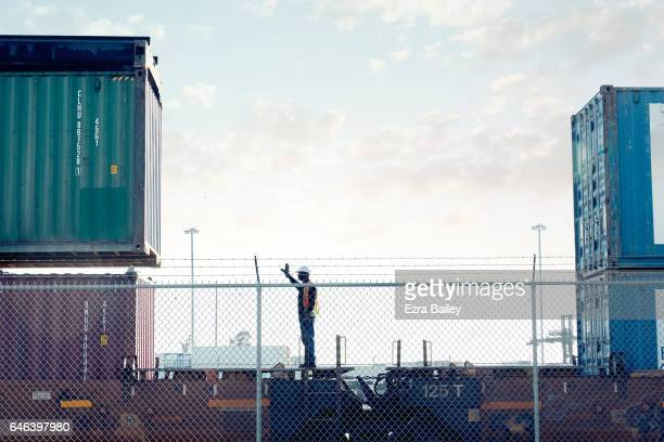 Man working at an industrial container port