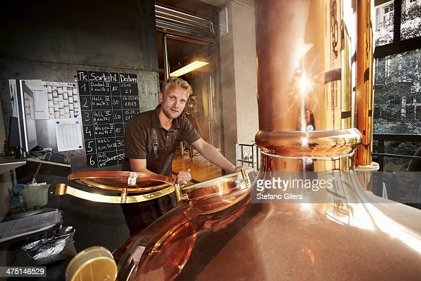 man working at brewery - brewery stock pictures, royalty-free photos & images