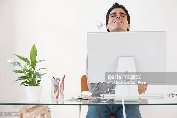 Man working at computer smiling