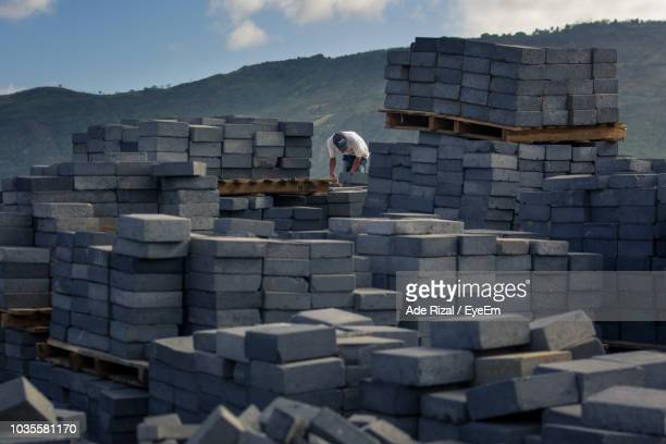 man working at construction site - ade rizal stock photos and pictures