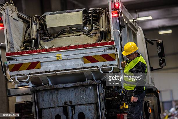 man working at garbage recycling plant - garbage truck stock pictures, royalty-free photos & images