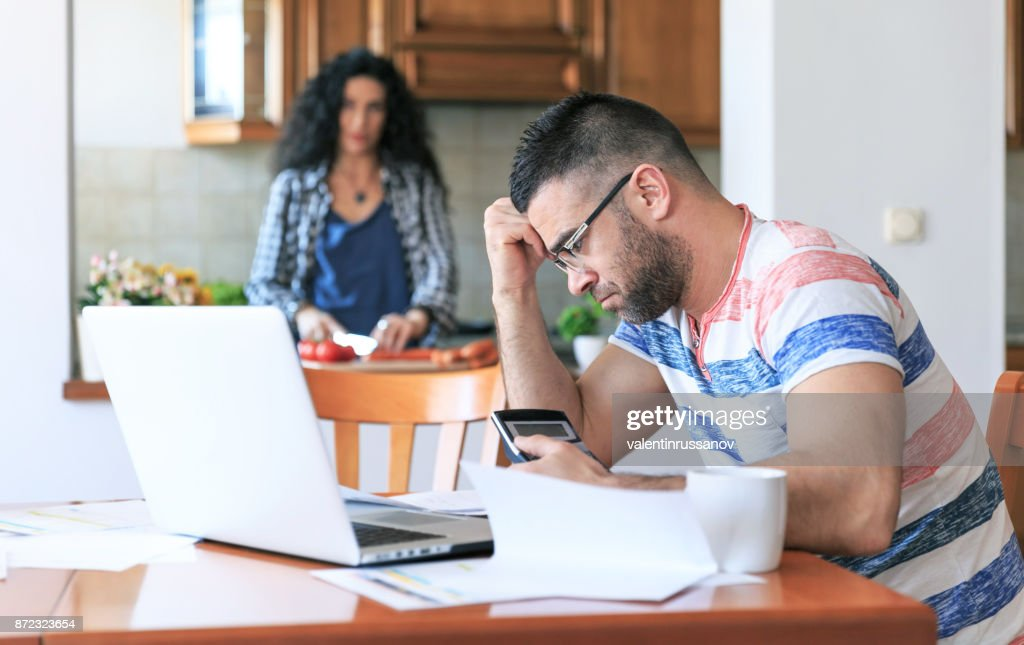 Man working at home, having problems : Stock Photo