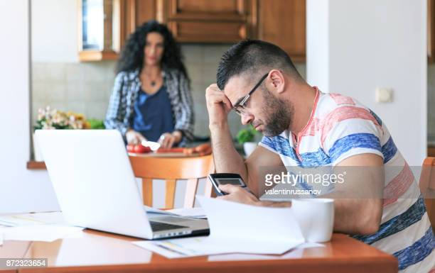 Man working at home, having problems
