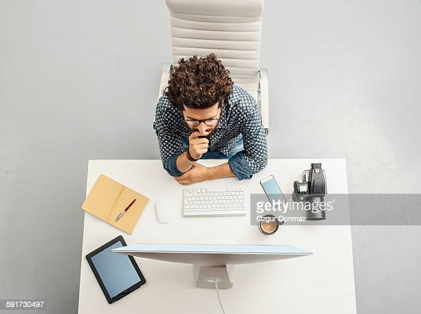 Man working at home office with computer