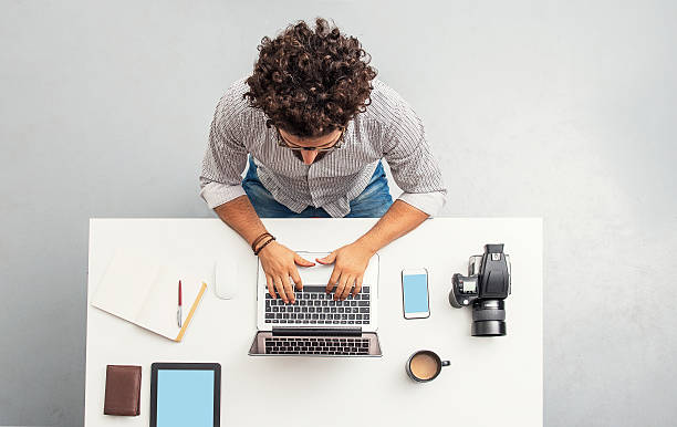 man working at home office with laptop picture