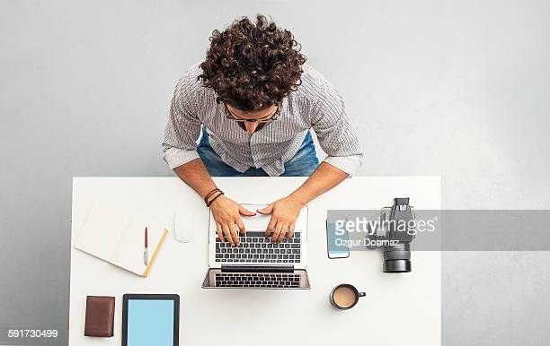 man working at home office with laptop - directly above stock pictures, royalty-free photos & images