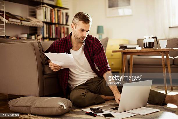 man working at home - bill legislation stock pictures, royalty-free photos & images