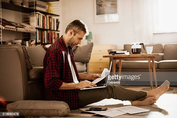 man working at home - employment law stock photos and pictures