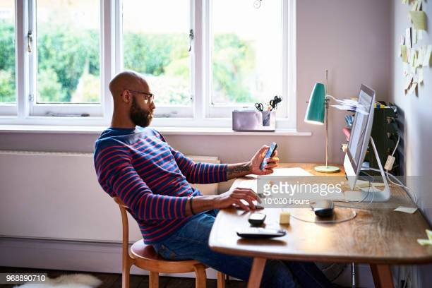 man working at home - three quarter length stock pictures, royalty-free photos & images