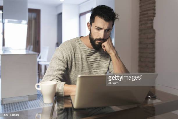 Man working at home with laptop computer