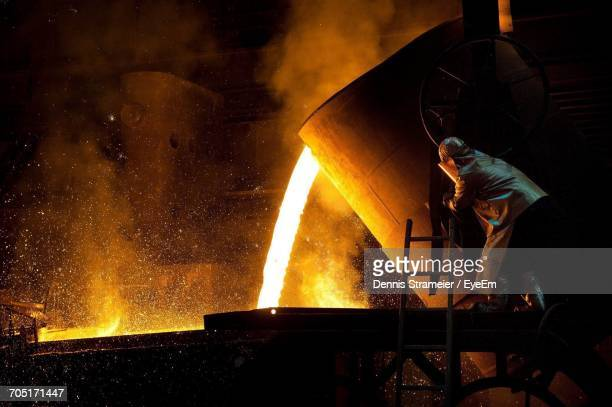 man working at night - metal industry stock pictures, royalty-free photos & images