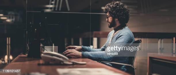 man working at night -working late - authors stock pictures, royalty-free photos & images