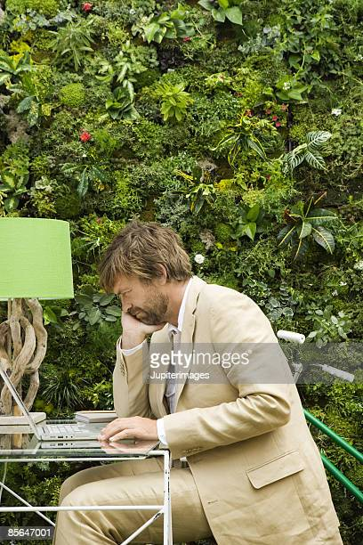 Man working at outdoor desk