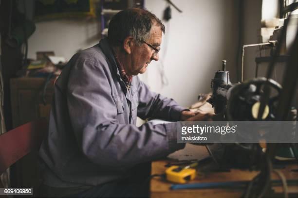 Man working at sewing machine