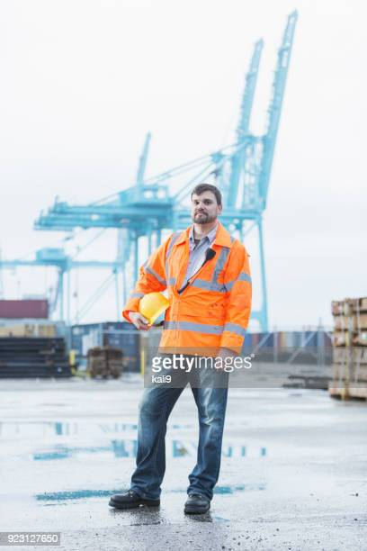 man working at shipping port - dock worker stock photos and pictures
