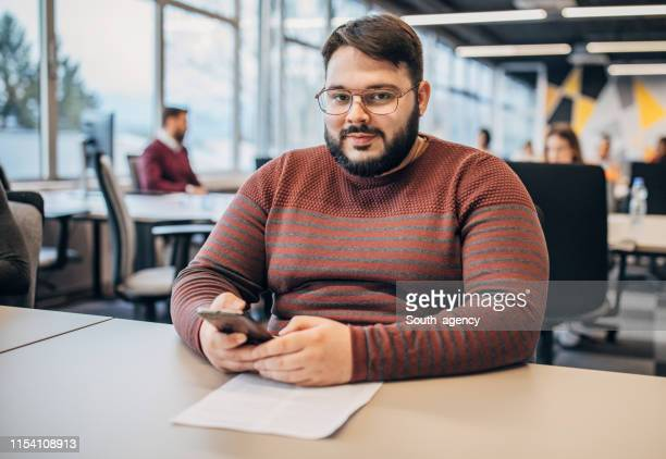man working at  the office - heavy stock pictures, royalty-free photos & images