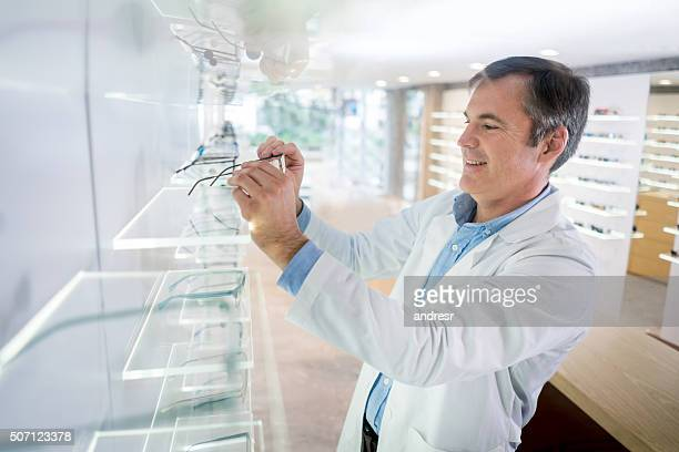 Man working at the optician's shop
