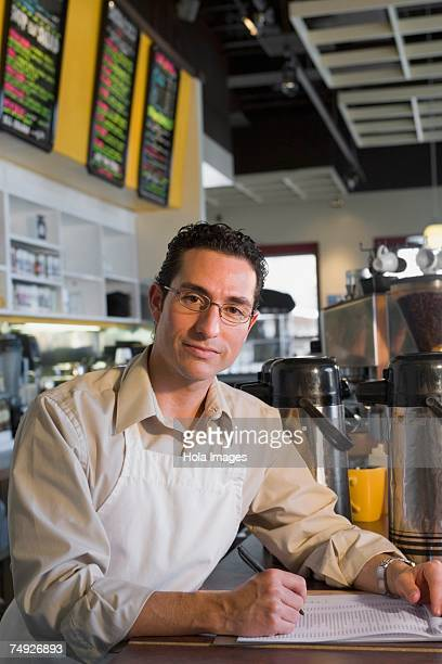 Man working behind counter at cafe