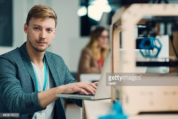 Man Working by 3D Printer in new staretup Business office.