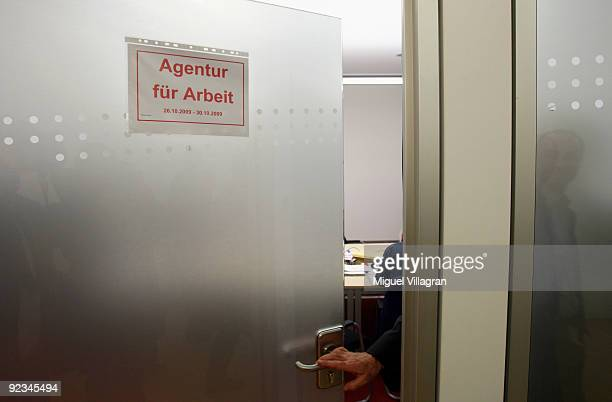 A man working for the governmentrun employment agency 'Agentur fuer Arbeit' opens a door of the counseling center at the headquarter of the German...