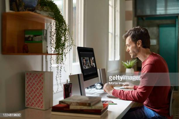 man working from home during coronavirus crisis - video conference stock pictures, royalty-free photos & images