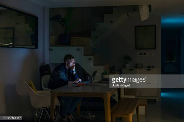 man working from home late at night - makeshift stock pictures, royalty-free photos & images