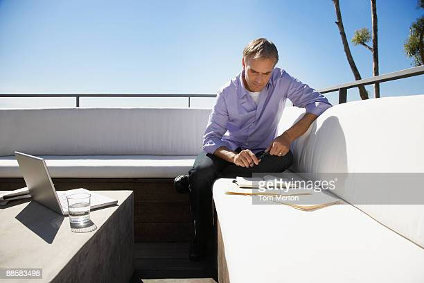 Man working from home on balcony