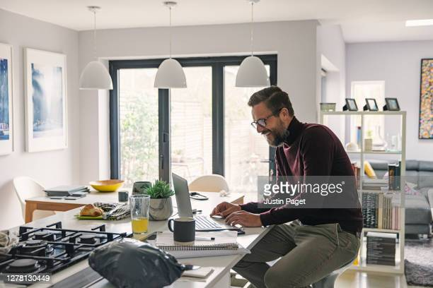 man working from home - learning stock pictures, royalty-free photos & images