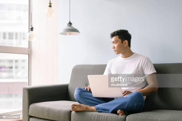 man working from home - tracksuit bottoms stock pictures, royalty-free photos & images