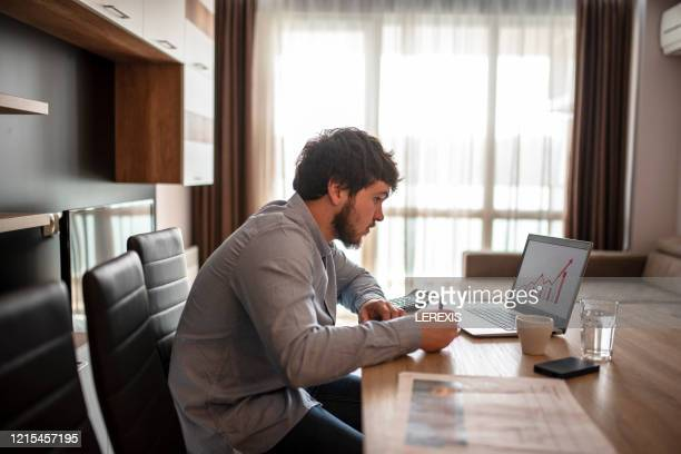 man working from home under quarantine - mid adult men stock pictures, royalty-free photos & images