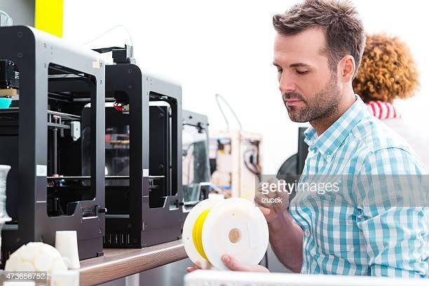 Man working in 3D printer office