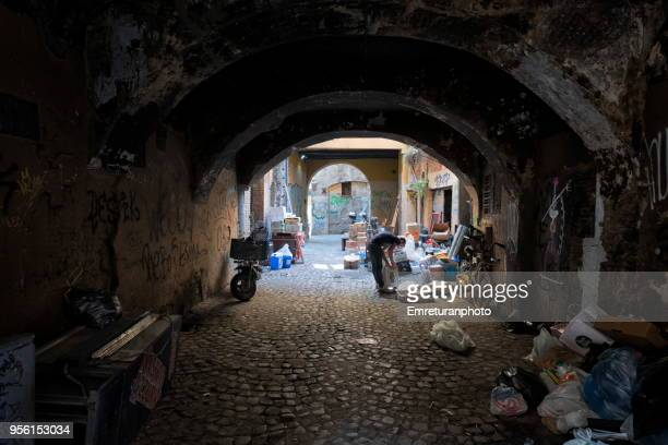 man working in a dark,old alley in rome. - emreturanphoto stock pictures, royalty-free photos & images