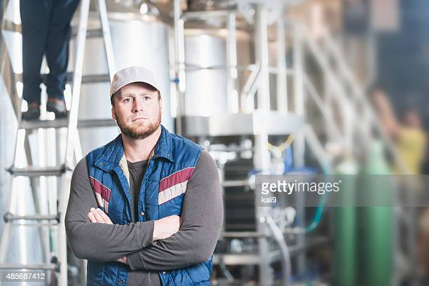 Man working in a microbrewery