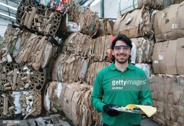 man working in a recycling factory - waste management stock pictures, royalty-free photos & images