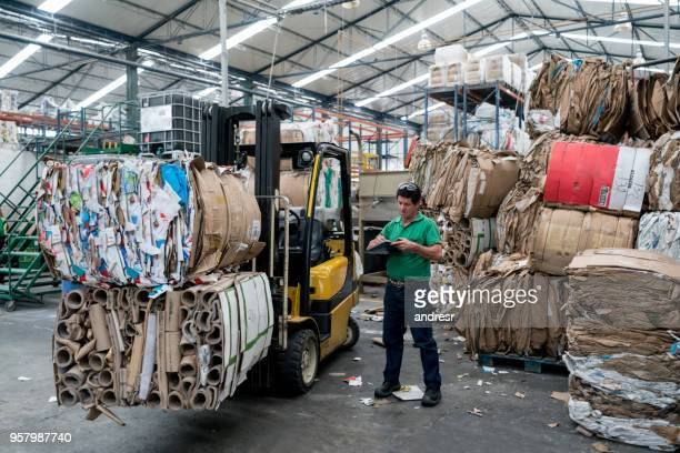 Man working in a recycling factory