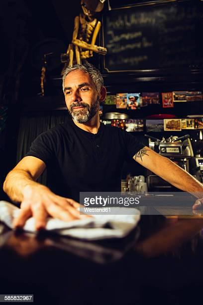 Man working in an Irish pub