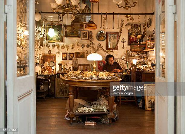 man working in antique shop